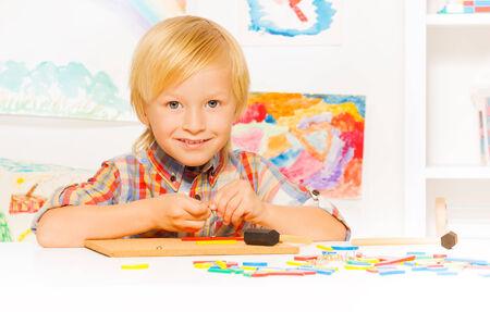 developmental: Boy busy with developmental game
