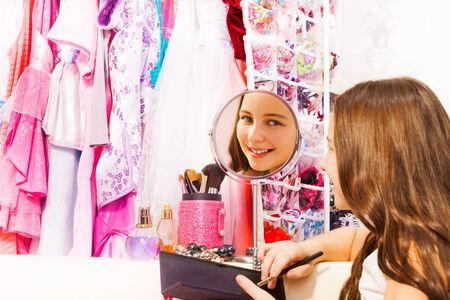 Beautiful pretty girl smiles in round mirror photo