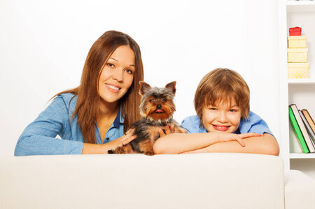 yorky: Mother with her son and Yorkshire dog lay on sofa