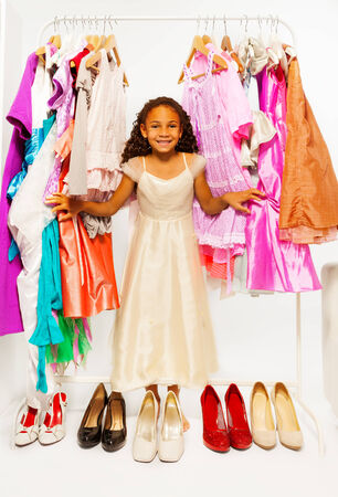 choosing clothes: Beautiful African girl choosing clothes in shop Stock Photo