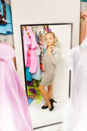 fitting room: Little girl try on dress in fitting room