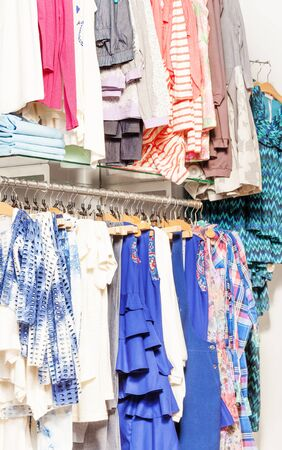 clothes hanging: Variety of women clothes hanging in the shop Stock Photo
