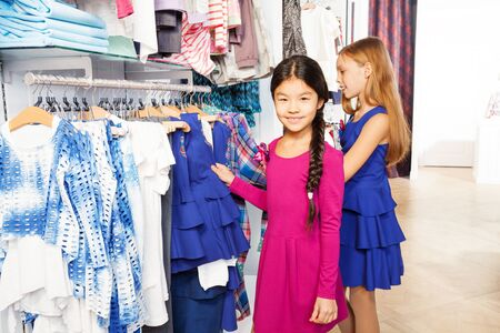 kids dress: Two small girls shopping together and smiling Stock Photo