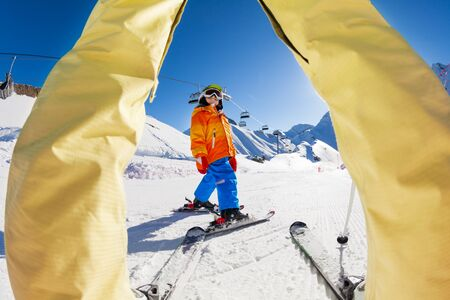 grownup: Skiing boy view between the legs of grown-up Stock Photo