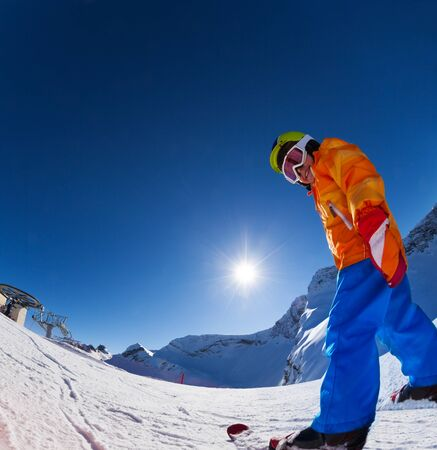 ski mask: Fisheye view of smiling boy in ski mask skiing