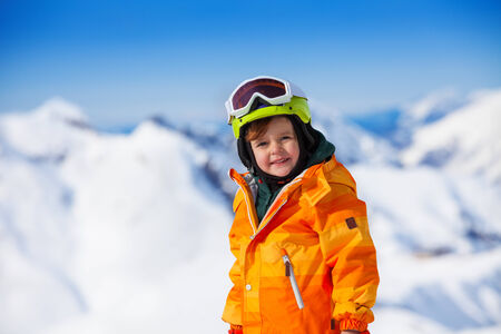 ski mask: Portrait of smiling boy with ski mask and helmet