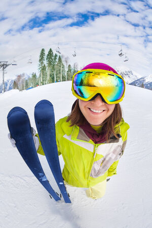 Smiling woman in ski mask close-up view from up