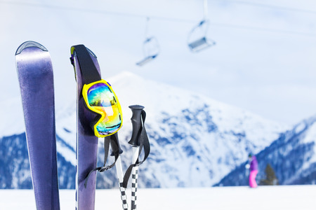 ski mask: Ski with mask and pole, chairlift on background Stock Photo