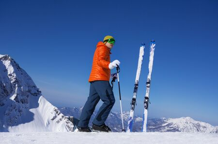 man standing alone: Young man standing alone with ski in snow