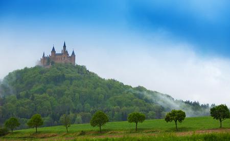 haze: Beautiful Hohenzollern castle in haze at summer Editorial