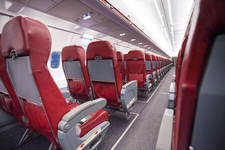 avia: Long aisle with rows of sits in airplane economy Stock Photo