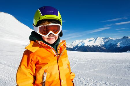 ski mask: Close-up view of boy wearing ski mask on ski-track Stock Photo