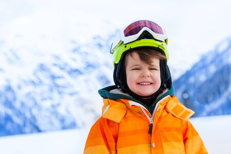 ski mask: Portrait of small boy in ski mask and helmet