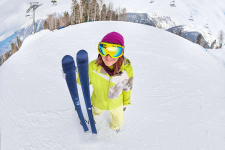 ski mask: Smiling young woman in ski mask on snow mountains