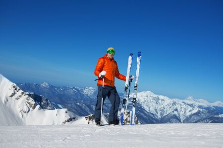 ski mask: Man in ski mask standing alone and beautiful mountain view on background in sunny weather on Krasnaya polyana, Sochi