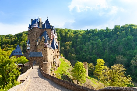 castle: Road to the Eltz castle with towers, in hills