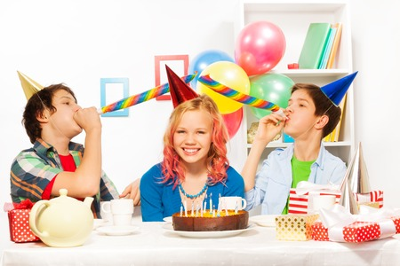 noisemaker: Birthday party with boys blow noisemaker horns