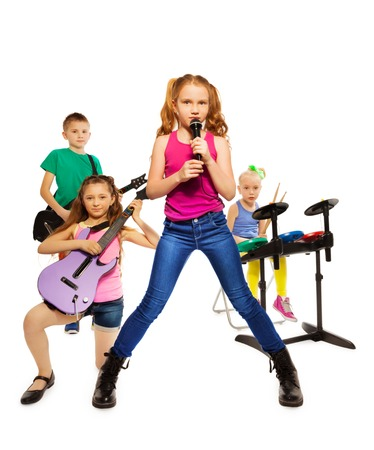 children play: Children play musical instruments as rock group