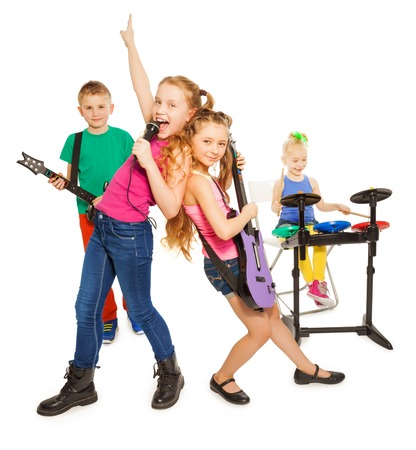 child singing: Girl singing and children playing as rock group