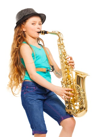 Smiling girl with hat playing alto saxophone
