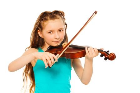 Small girl holding string and playing on violin Stock Photo