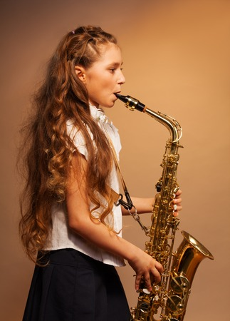 Half-face view of girl playing alto saxophone