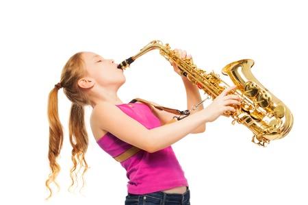 Happy girl playing saxophone on white background