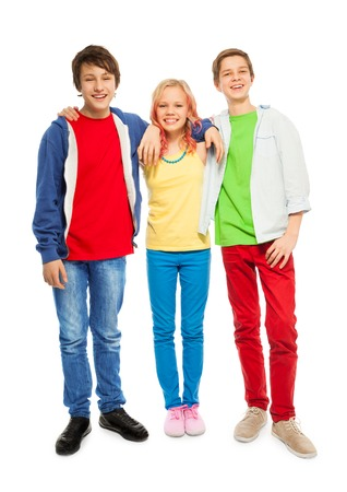 blonde boy: Three cute teens stand with hands on shoulders Stock Photo