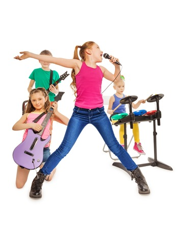 sings: Children play musical instruments and girl sings Stock Photo