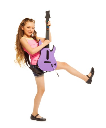 girl playing guitar: Girl with long hair plays on electro guitar