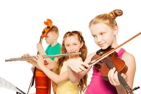 Close-up view of kids playing musical instruments