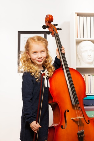 fiddlestick: Curly beautiful girl with fiddlestick, violoncello