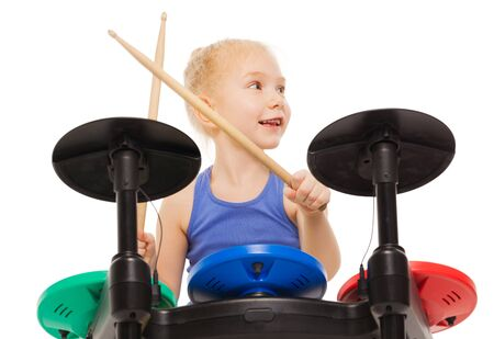 cymbals: Close-up view of small girl playing on cymbals Stock Photo