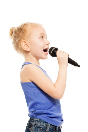 Portrait of small girl singing in microphone Stock Photo