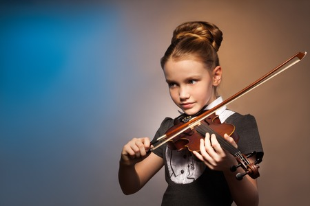 fiddle: Beautiful girl alone playing on the violin