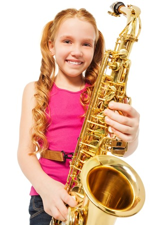 Portrait of happy girl playing alto saxophone Zdjęcie Seryjne