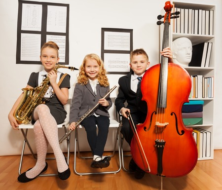 fiddlestick: Happy group of kids playing musical instruments