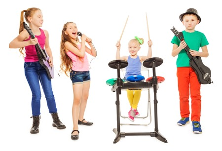 Cute children playing instruments and girl sings