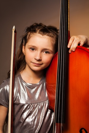 Girl with violoncello and string on gel background photo