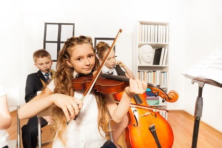 Performance of kids playing musical instruments photo
