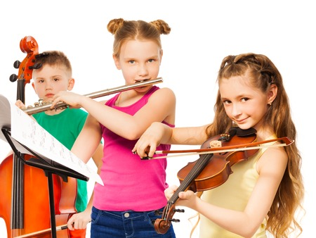 school band: Group of children playing on musical instruments Stock Photo