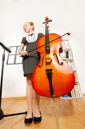 the view from below: View from below of girl playing violoncello
