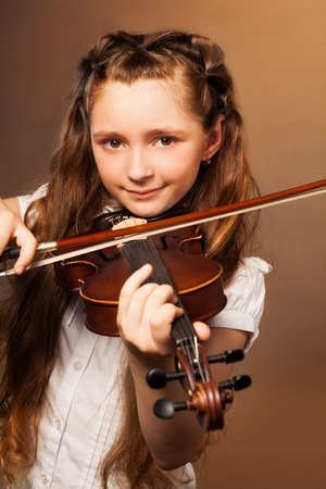 fiddlestick: Girl with long hair plays violin on gel background