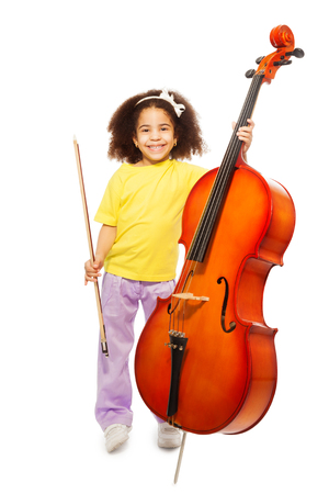 violoncello: Smiling African girl holding cello and fiddlestick