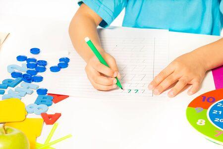 mark pen: Fragment of kids hands holding mark pen  writing Stock Photo