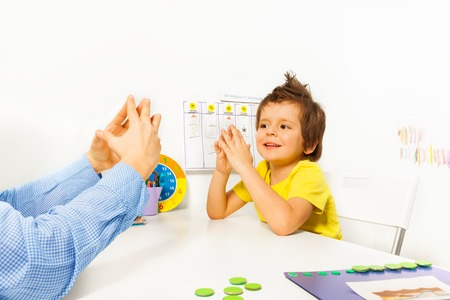 and activities: Smiling boy exercises improving motor skills
