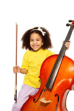 fiddlestick: Cheerful African girl holds cello with fiddlestick