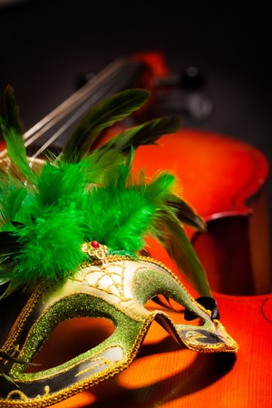 violoncello: Close view of Venetian mask with on violoncello