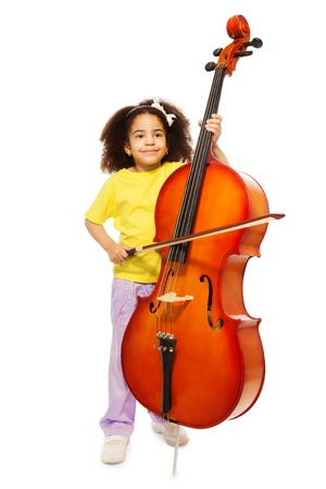 fiddlestick: Beautiful African girl holds cello and fiddlestick Stock Photo