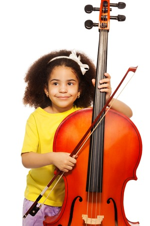 violoncello: African girl holding violoncello and playing Stock Photo